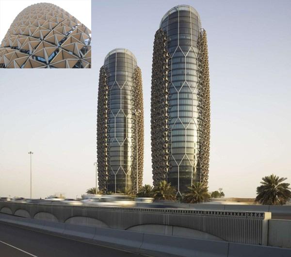 Tháp văn phòng 29 tầng Al Bahar Abu Dhabi, UAE, đóng kín ĐHKK,  che nắng cho tường toàn kính 3 mặt (trừ Bắc), giảm được 50% BXMT.